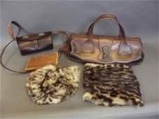 A leather gladstone type handbag, bears Gucci label, a