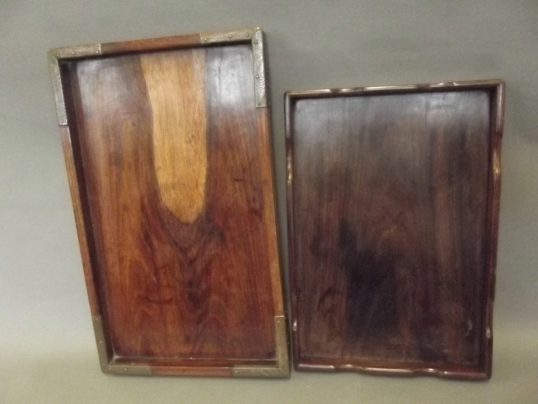 A Chinese hardwood tray with brass bound corners, and
