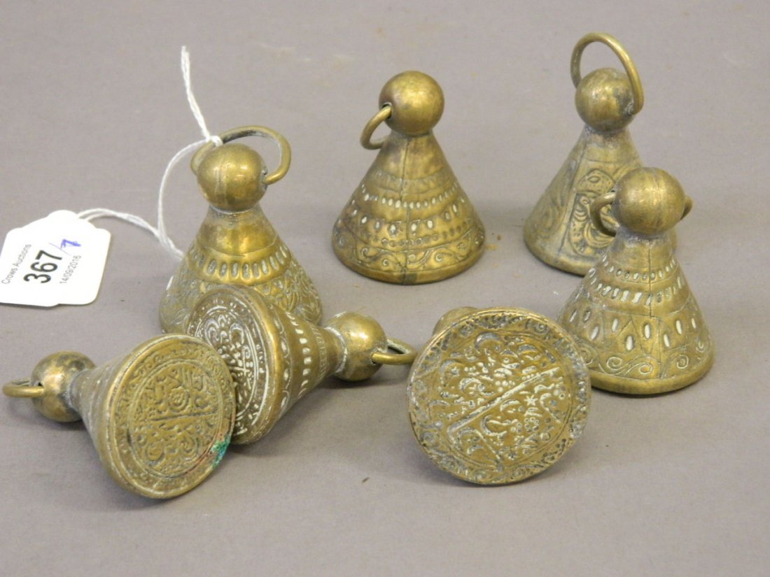 A collection of seven Islamic brass seals