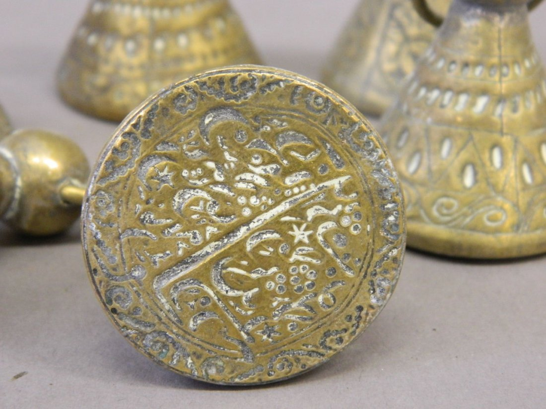 A collection of seven Islamic brass seals - 2