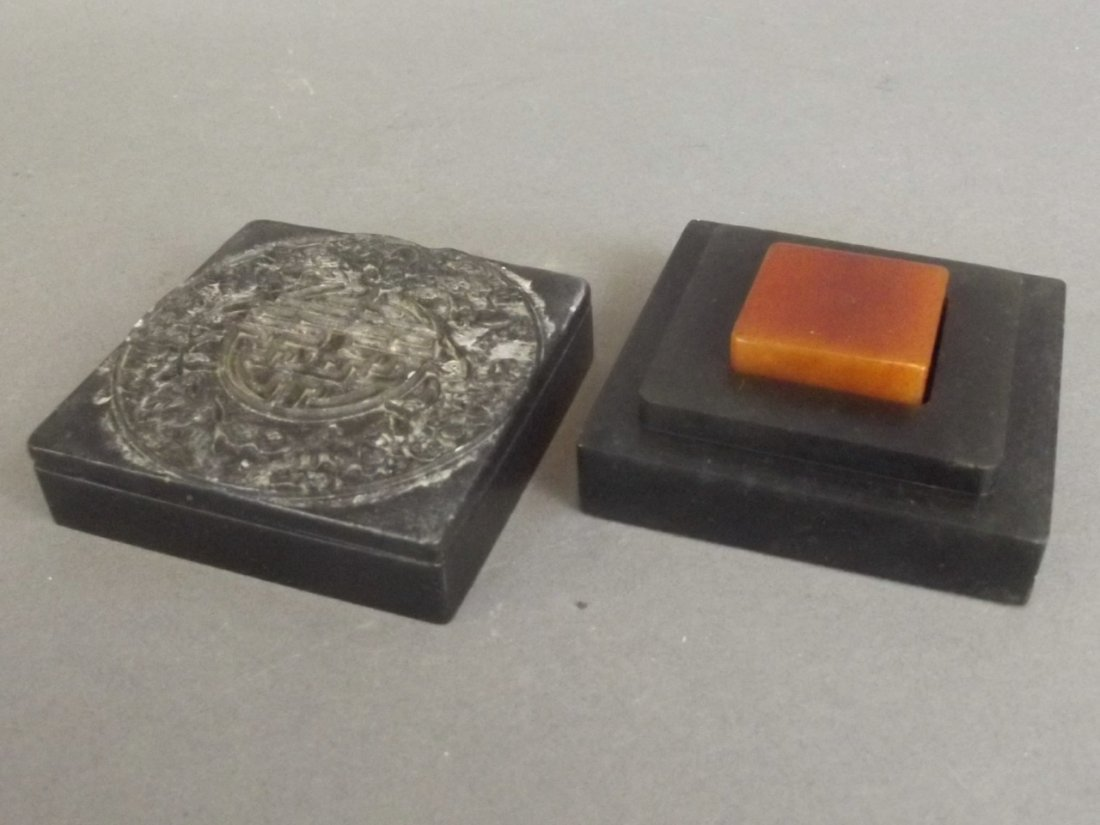 A Chinese spinach soapstone box with carved bat and