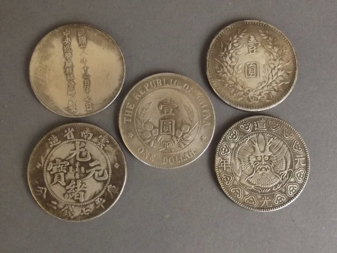 A set of five silvered metal Chinese coins, 1½""
