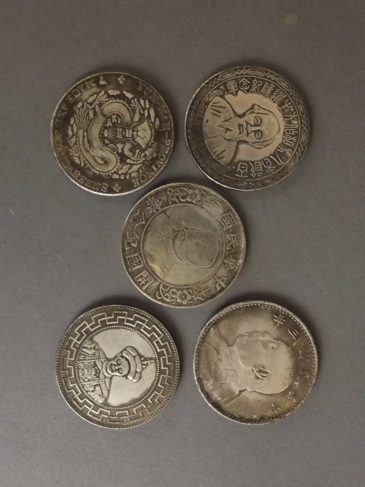 "A set of five silvered metal Chinese coins, 1½"" - 2"