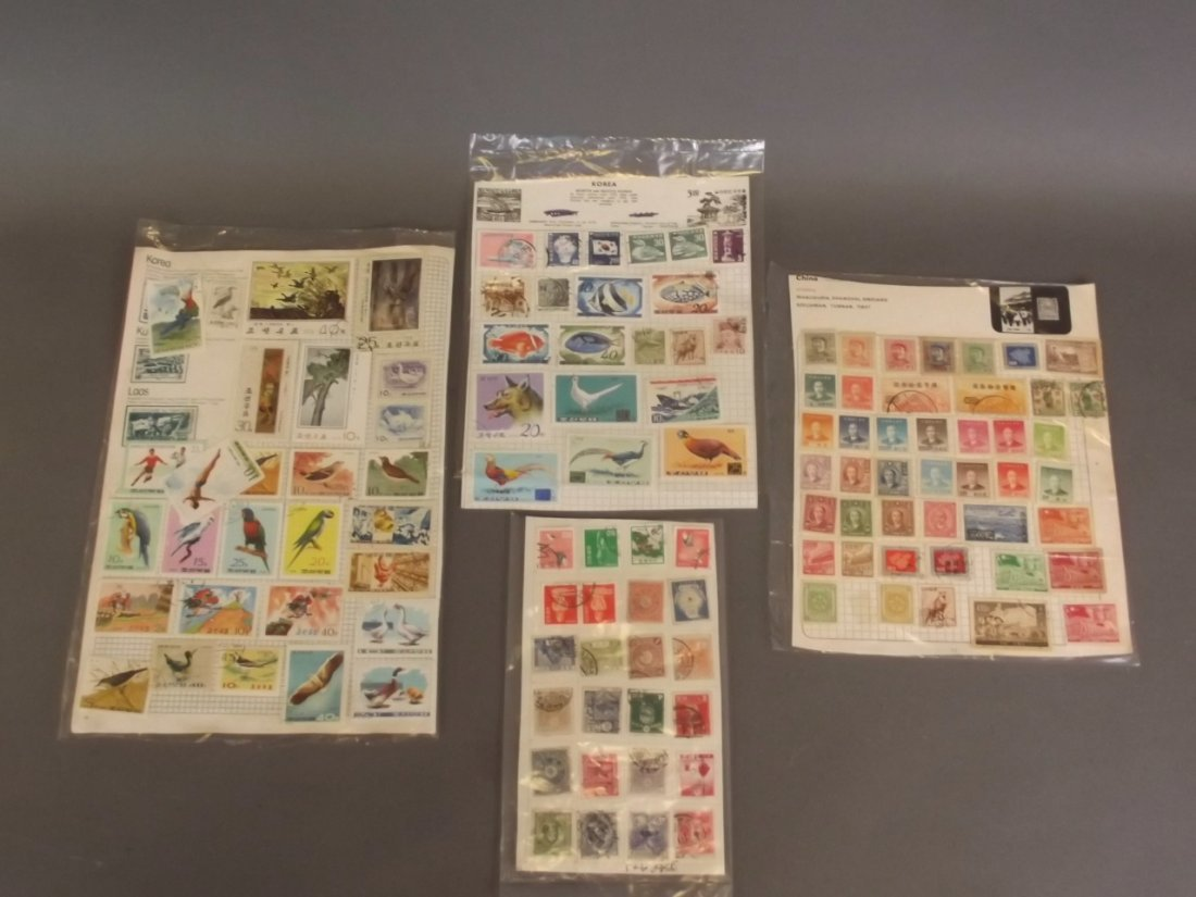 Four sheets of Oriental stamps, Japan, China, Korea