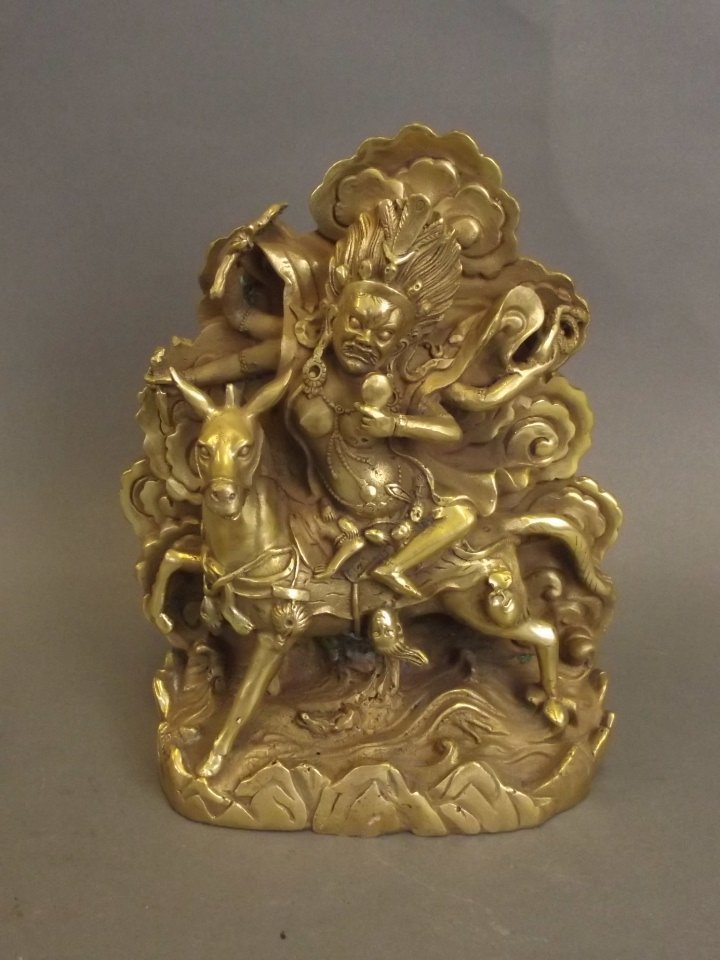"""A Sino-Tibetan brass figure of Palden Lhamo, 8"""" high"""