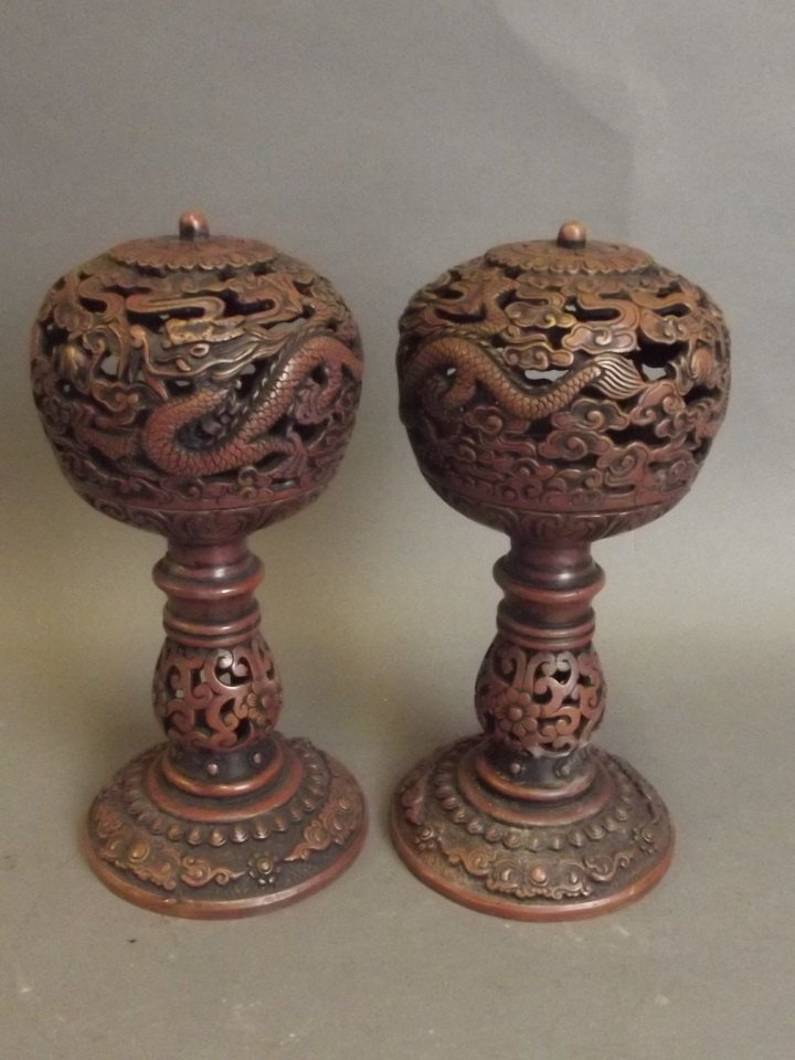 A pair of Chinese coppered metal pierced ball censers