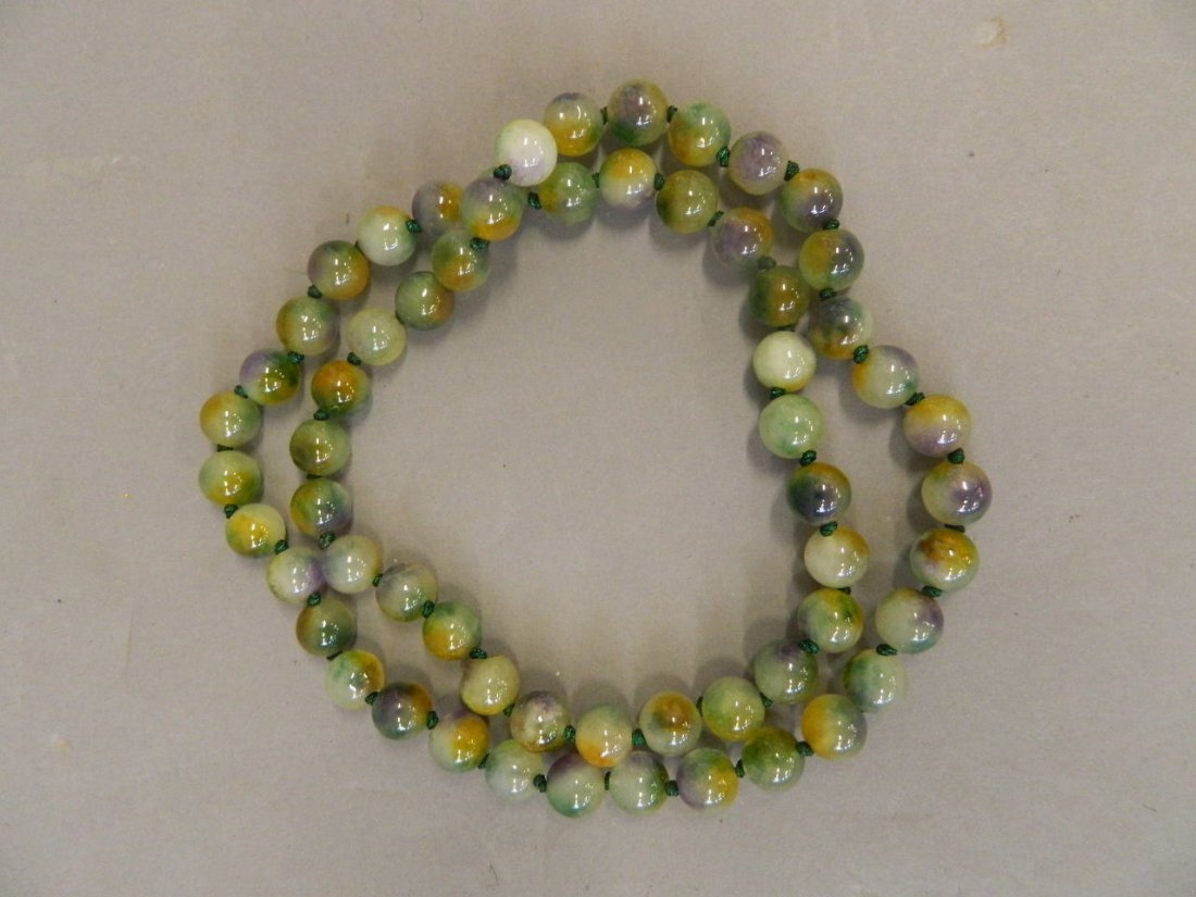 """A string of tri-colour jade beads, 31"""" long"""