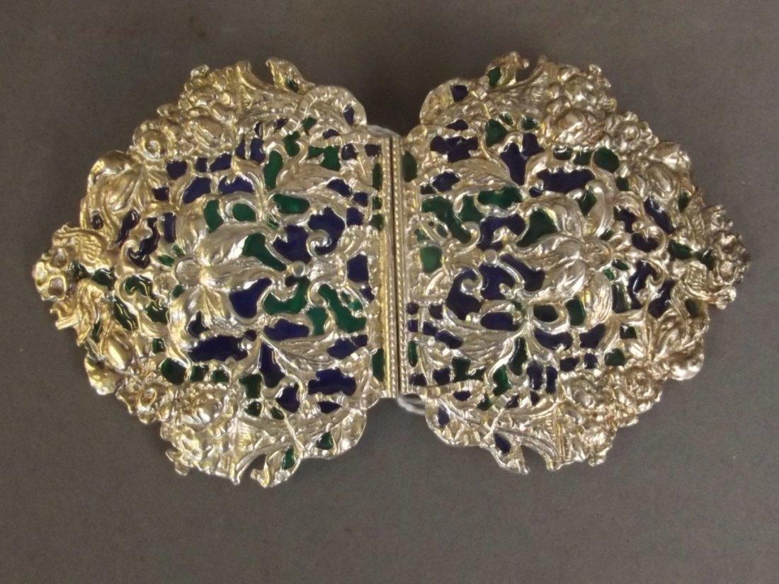 An ornate silver plate and plique-à-jour nurse's