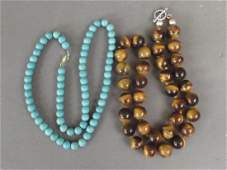 A tigers eye bead necklace and a turquoise bead