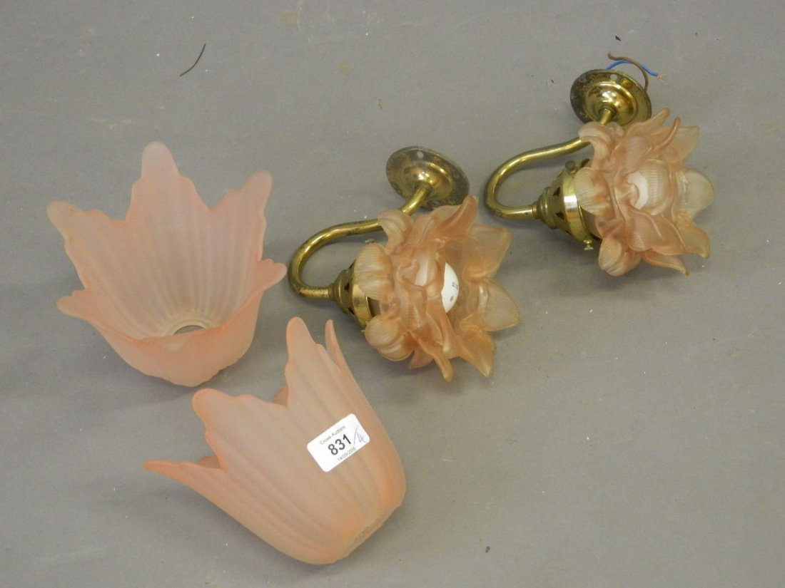 A pair of brass wall lights with frilled glass shades,