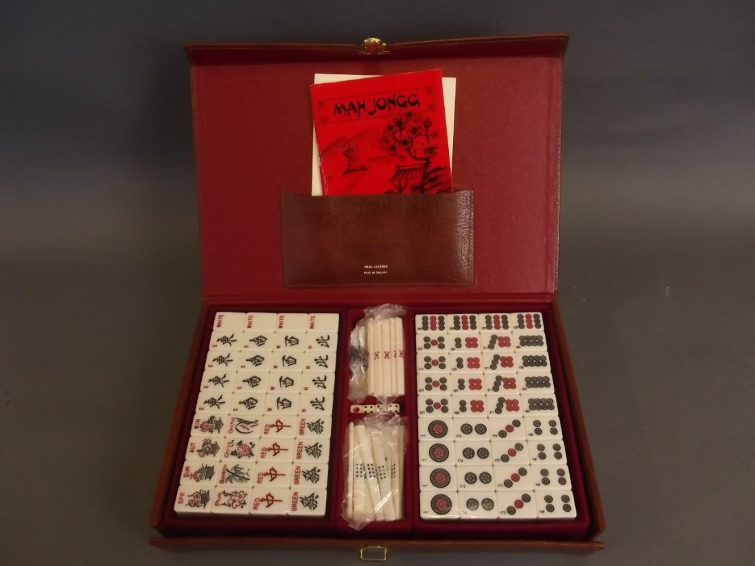 A leather cased Mahjong set with instructions