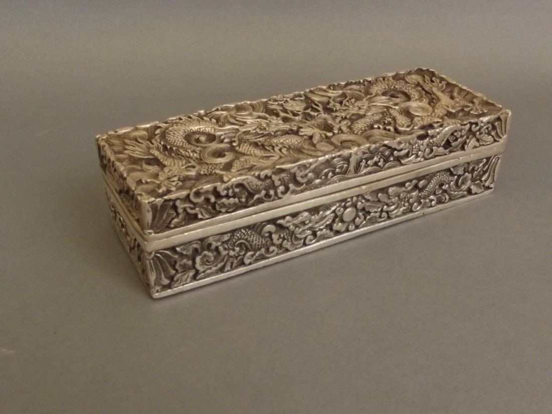 A Chinese white metal scribe's box with incised twin
