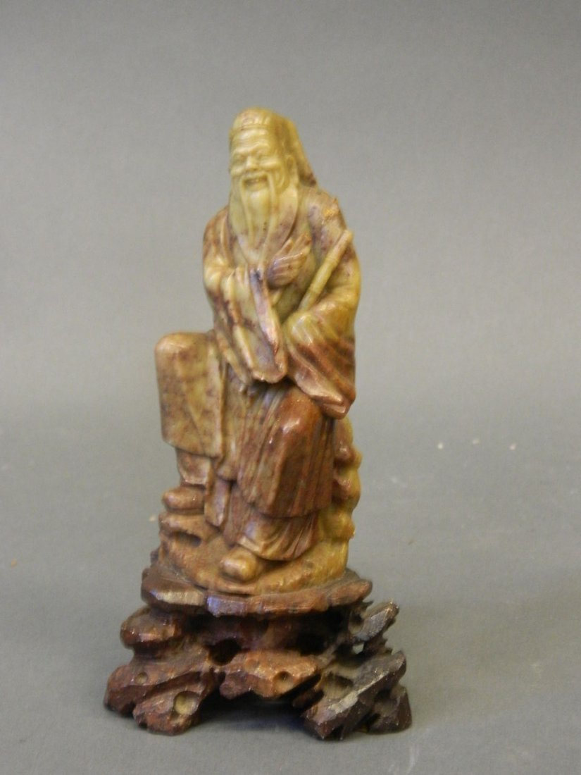 "A Chinese soapstone carving of a smiling sage, 6"" high"