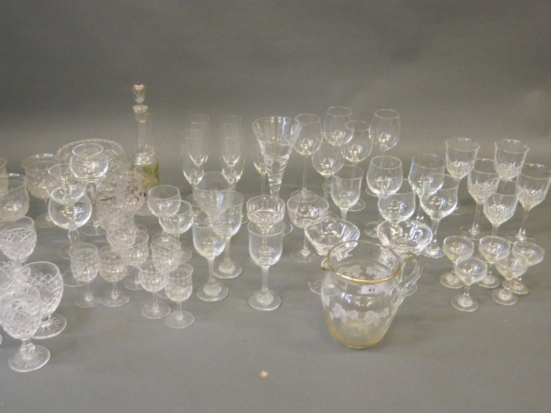 A large quantity of drinking glasses to include