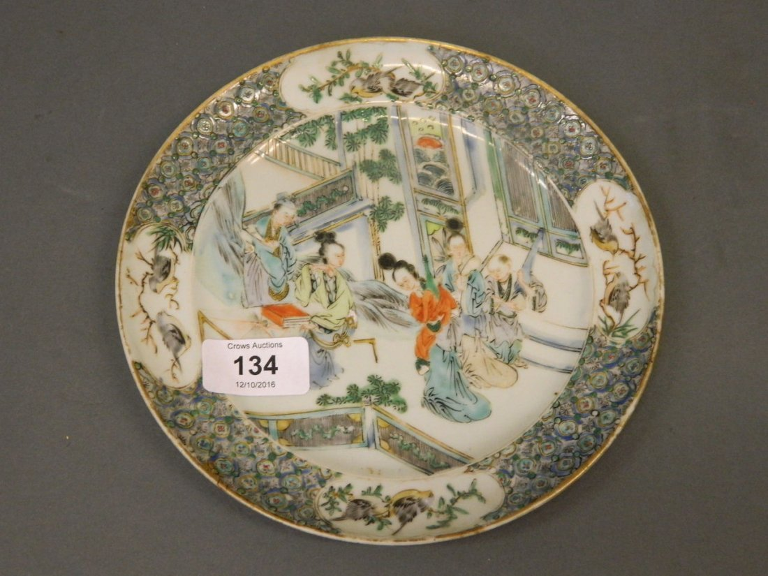 A C19th Chinese famille verte plate with raised enamel