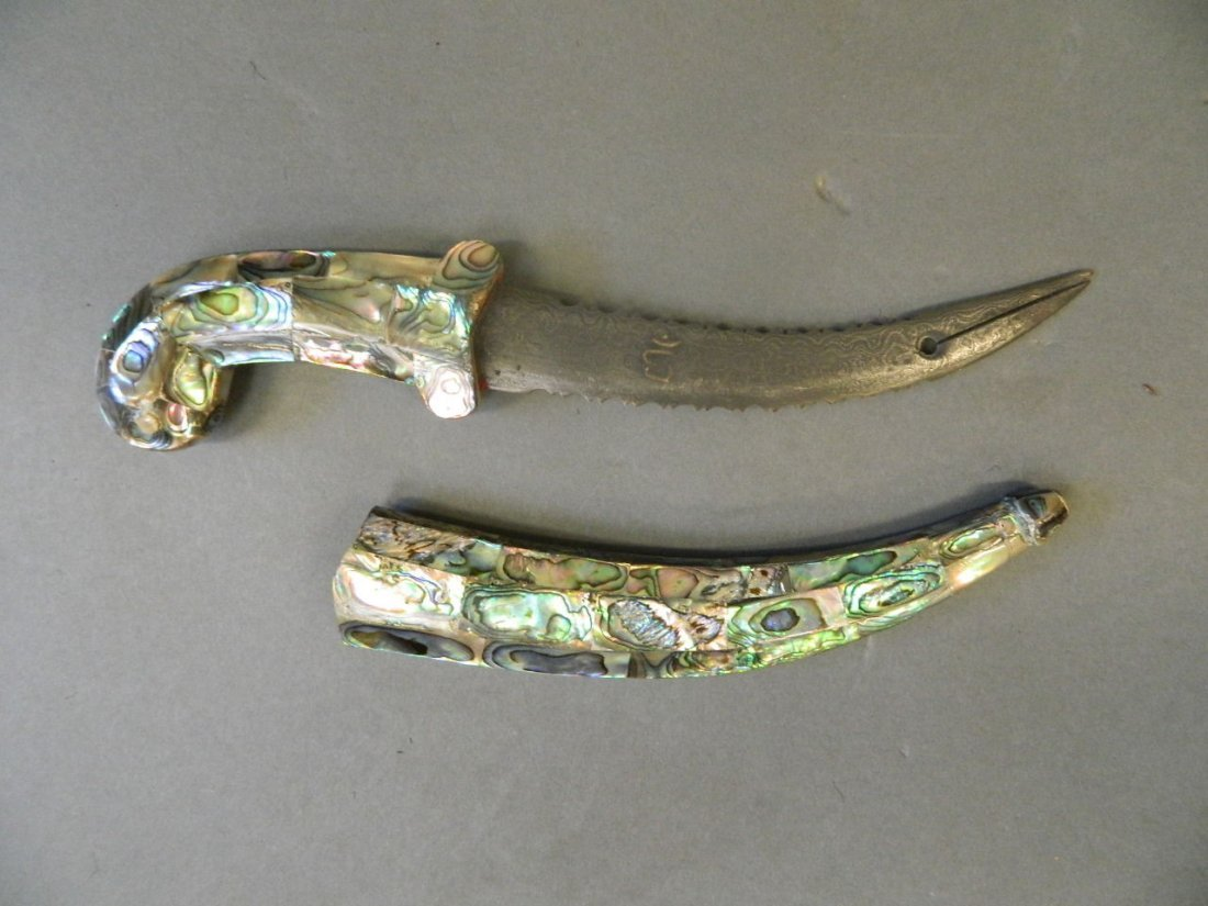 An Islamic serrated dagger with a sectional abalone
