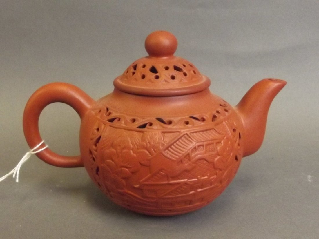 A Chinese Yixing terracotta teapot with pierced temple