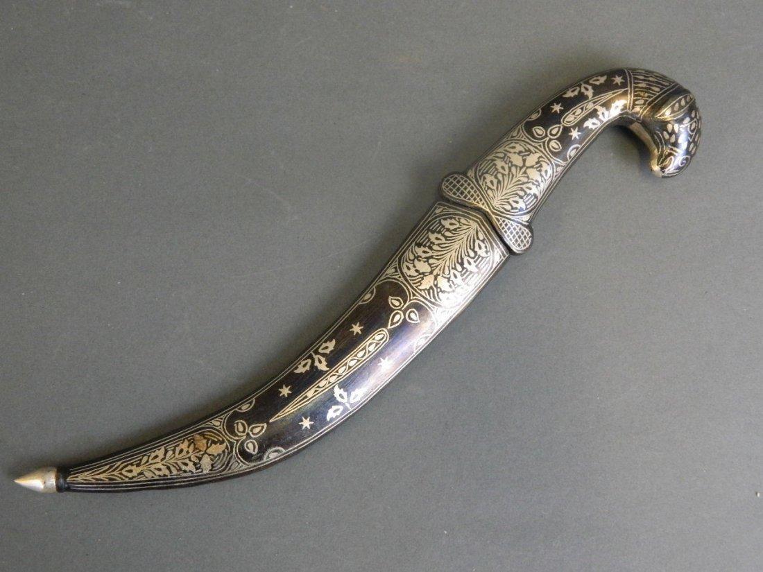 A Bidri style dagger with white metal sheath, the hilt