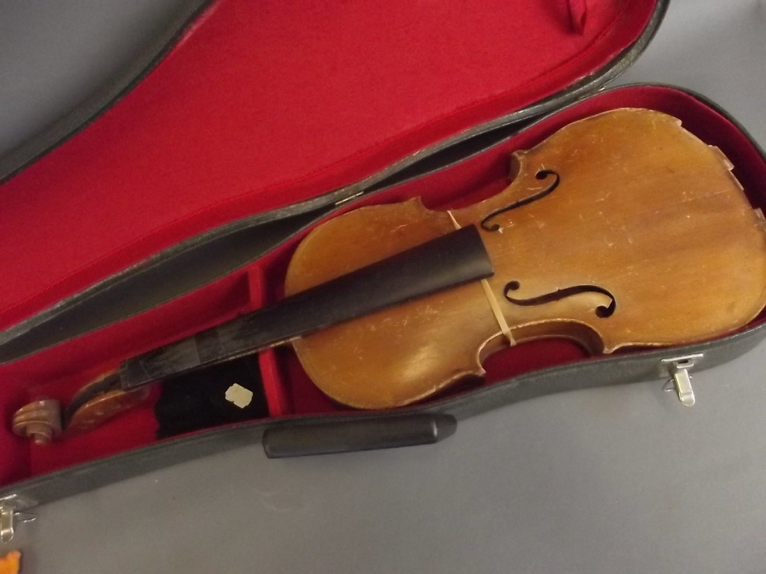 A violin with two piece back, bears label 'G.