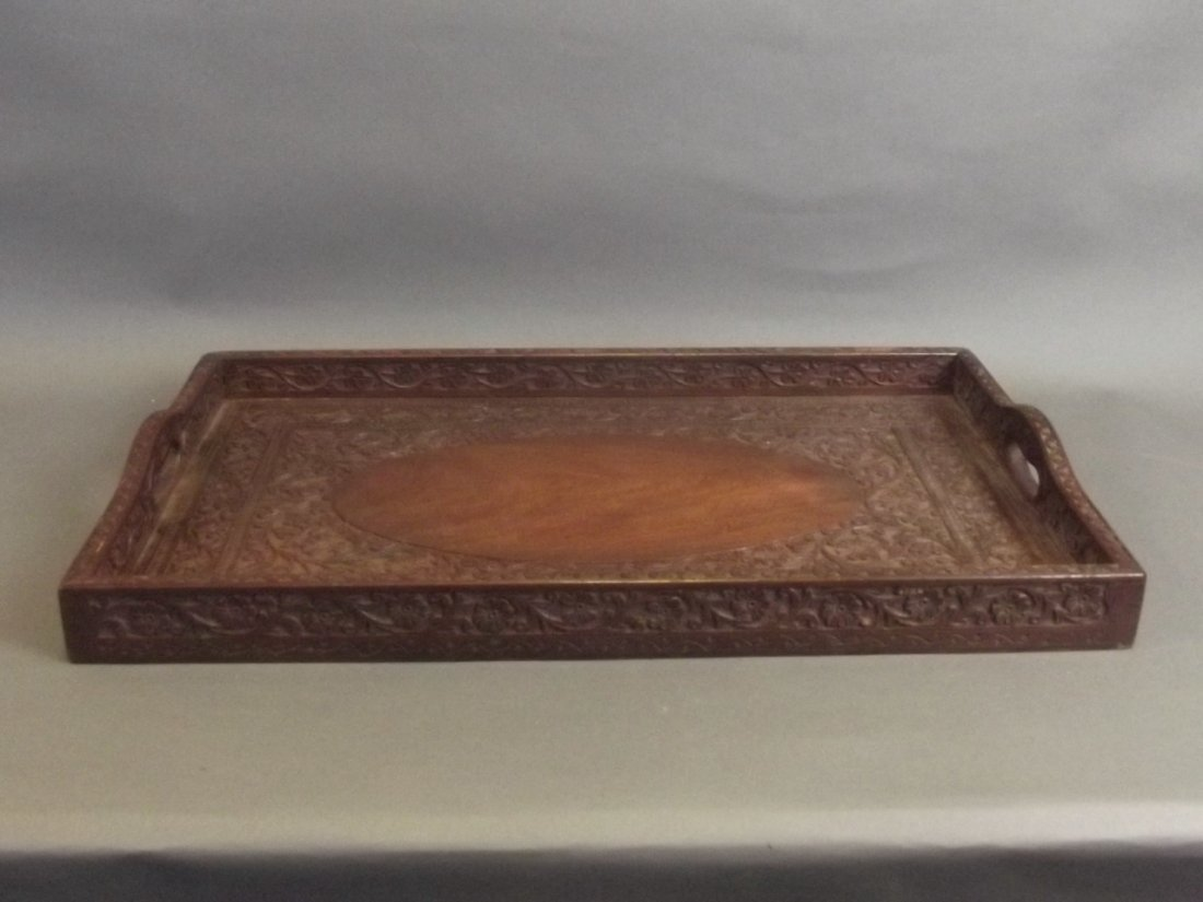 An Indian carved hardwood tray with scrolling floral - 2