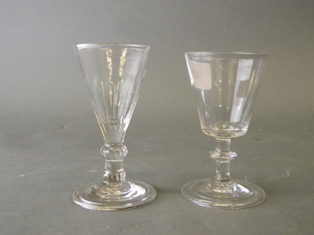 A late C18th gin glass with folded foot base, and
