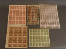 A collection of four facsimile Chinese stamp sheets,