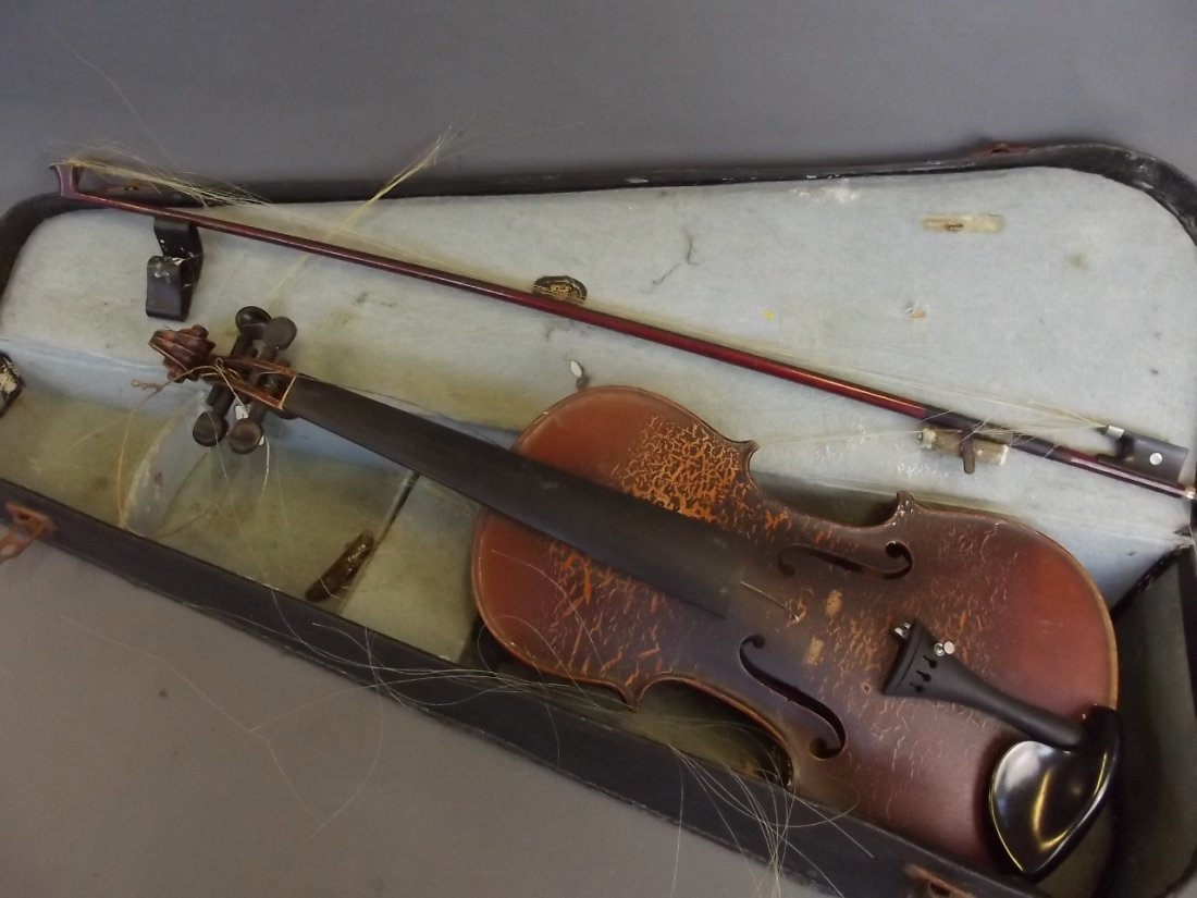 An early violin and bow with two piece back, in a case
