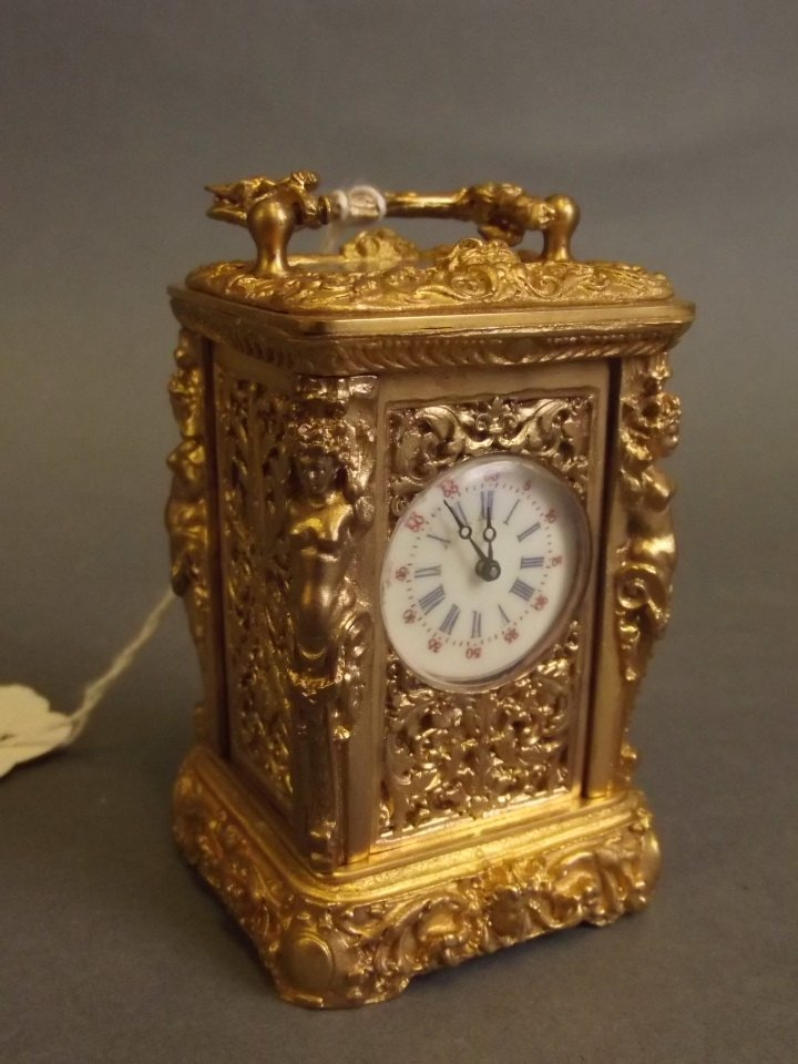 A brass rococo style cased miniature carriage clock, 3""