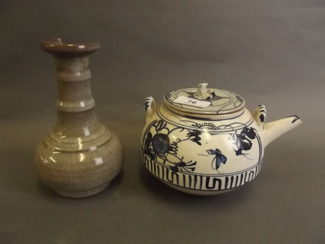 A Chinese stoneware teapot with blue and white floral