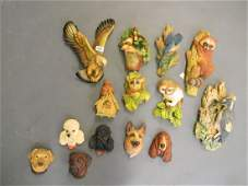 A collection of Bosson's wall masks including dogs and