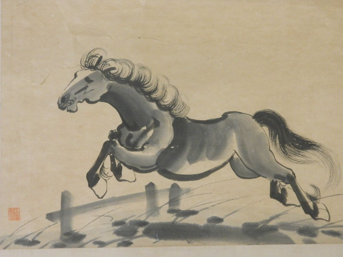 A Chinese monotone watercolour of a horse taking a