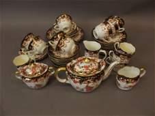 A Royal Crown Derby three piece tea set comprising