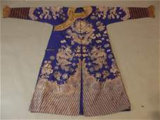 A late C19thearly C20th Chinese silk robe with silver