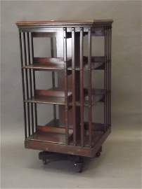 A large Victorian mahogany revolving bookcase with