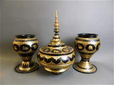A collection of three Thai black lacquer offering bowls