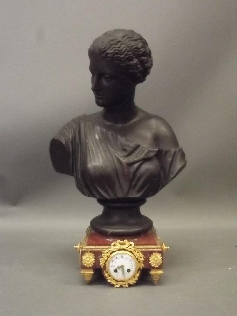 A late C19th mantle clock with classical terracotta