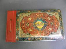 A Persian foil covered photo album decorated with a