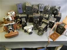 A collection of vintage cameras including Altix