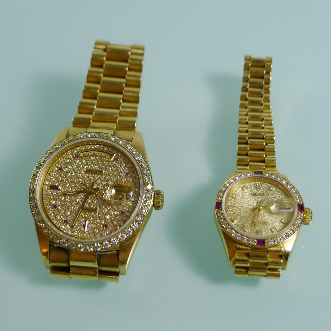 A PAIR OF 18K GOLD ROLEX RUBY & DIAMOND