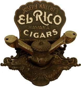 El Rico Cigar Cutter.