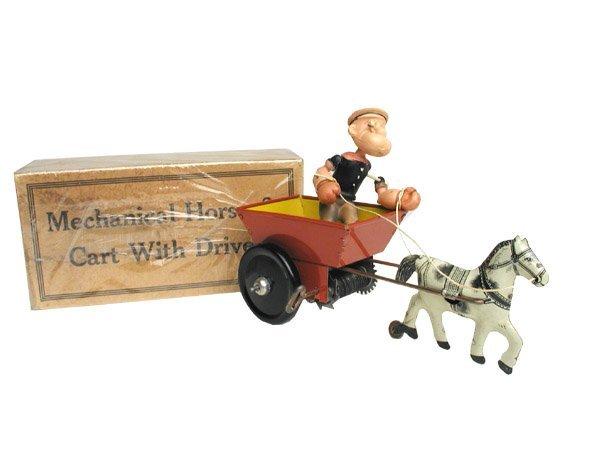 506: Marx Popeye in Cart in O/B.
