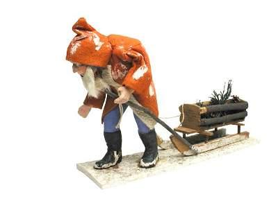 557: German Santa Pulling Sleigh.