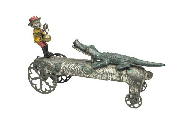 582: C.I. Boy Teasing Alligator Bell Toy.