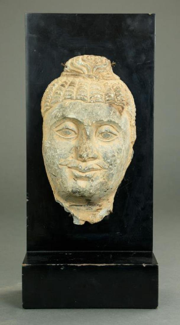 ANTIQUE CARVED STONE FRAGMENT OF BUDDHA HEAD