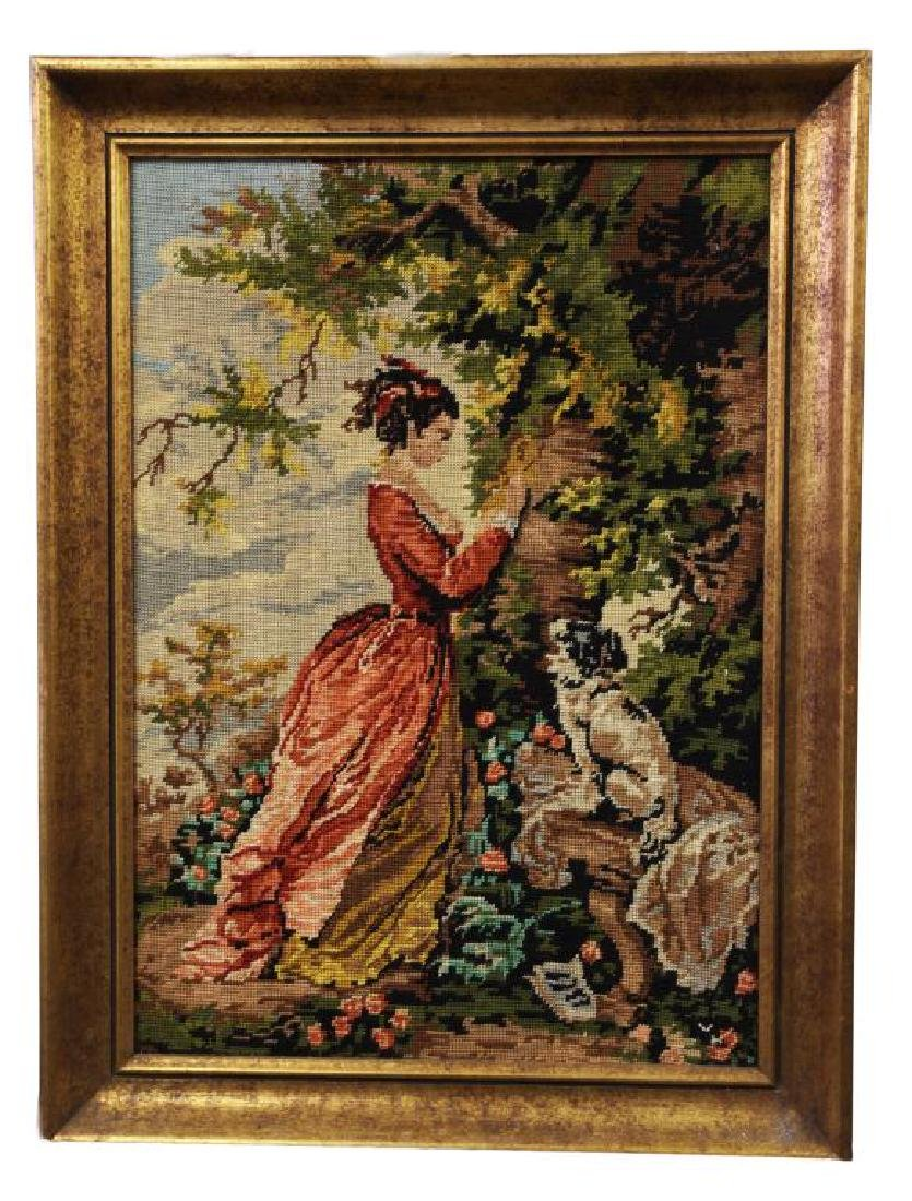 FRAMED NEEDLEPOINT STITCHWORK, OF A GIRL AND A DOG