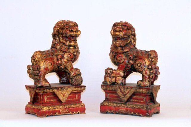 PAIR OF CARVED CHINESE WOODEN FOO LIONS