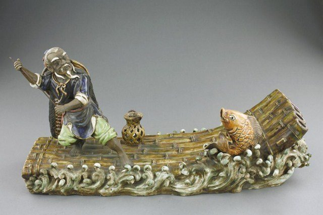 CHINESE PORCELAIN FIGURAL GROUP, OF A FISHERMAN