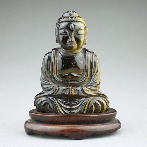 CHINESE CARVED TIGER'S EYE OF A SEATED BUDDHA