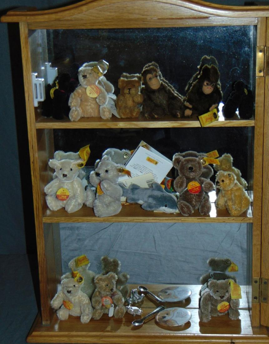 Miniature Steiff Lot in Glass Showcase.