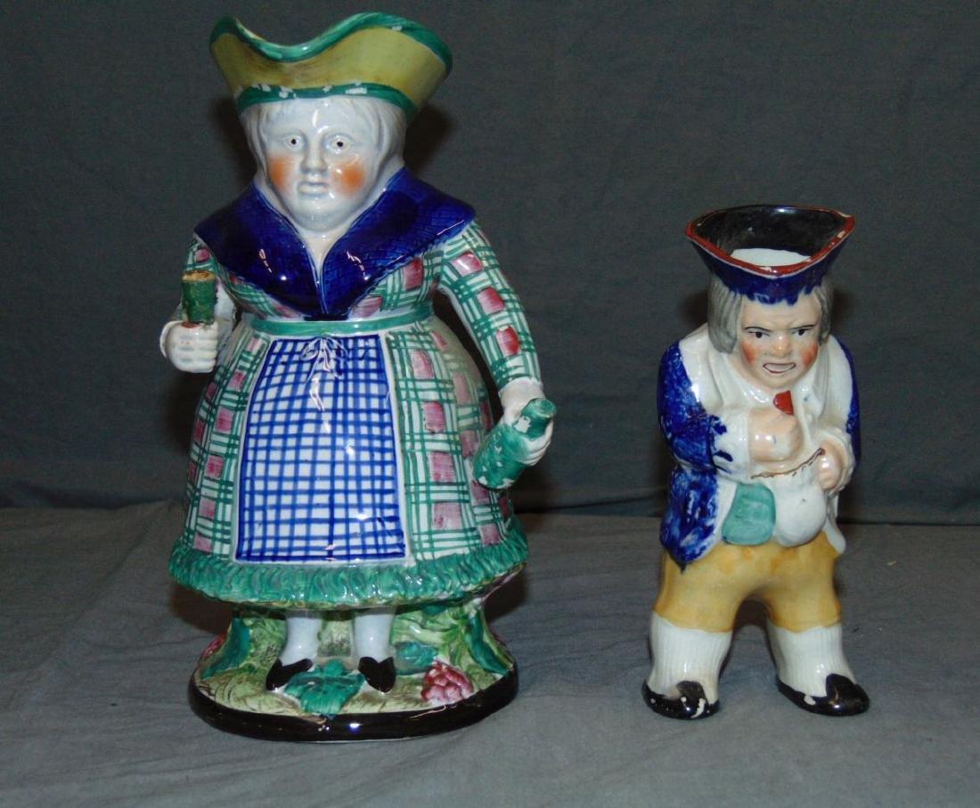 "Pair of Porcelain ""Toby"" Mugs."